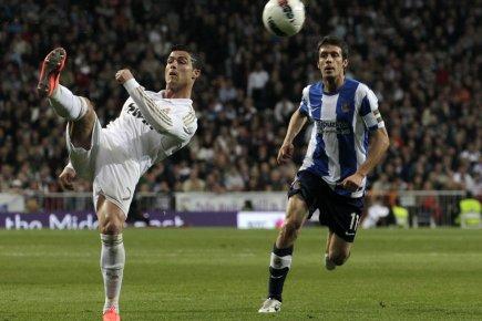 En marquant deux buts, Cristiano Ronaldo (gauche) a... (Photo : Juan Medina, Reuters)