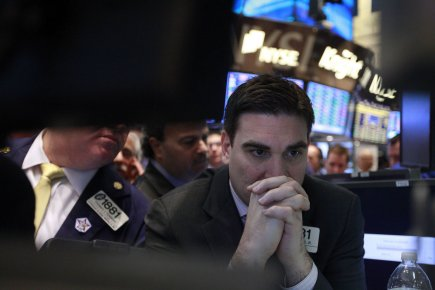La Bourse de New York a fini en baisse lundi, déprimée par la poursuite  de la... (Photo Reuters)