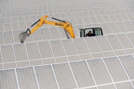 L'entreprise GREENoneTEC a  produit des panneaux solaires... (Photo: Archives Reuters)