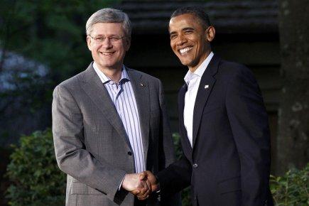 Le président américain Barack Obama accueille le premier... (Photo Reuters)