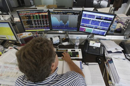 Les Bourses européennes ont fini dans le vert lundi, portées par  l'espoir de... (Photo: archives AP)