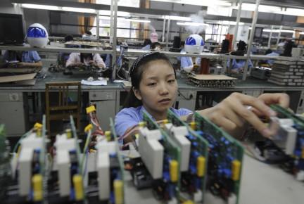 Alors que l'activité manufacturière a atteint en juin... (Photo AFP)