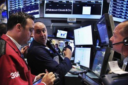 Wall Street a terminé en hausse vendredi, tirée par les valeurs financières qui... (Photo Reuters)