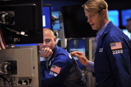 La Bourse de Toronto a clôturé lundi en baisse, les opérateurs s'étant... (PHOTO STAN HONDA, AFP)