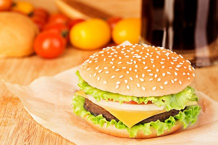43899942 - delicious hamburger on brown paper on...
