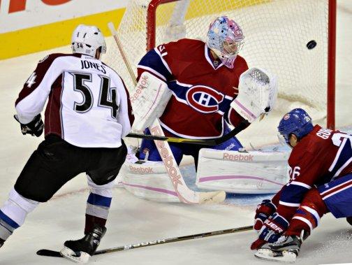 Carey Price est déjoué pour la deuxième fois du match par David Jones de l'Avalanche. (Bernard Brault, La Presse)