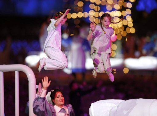 Performers take part in the opening ceremony of the London 2012 Olympic Games at the Olympic Stadium July 27, 2012.           REUTERS/Mike Segar (BRITAIN  - Tags: OLYMPICS SPORT) (MIKE SEGAR)
