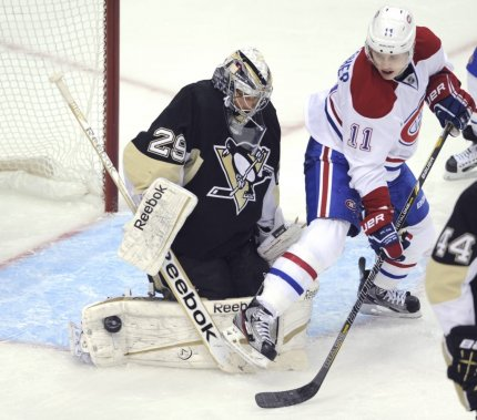 Pittsburgh Penguins goaltender Marc-Andre Fleury (29) makes a save against the Montreal Canadiens Brendan Gallagher (11) in the first period of their NHL hockey game in Pittsburgh, Pennsylvania, April 17,  2013. REUTERS/David DeNoma (UNITED STATES - Tags: SPORT ICE HOCKEY) (DAVID DENOMA)