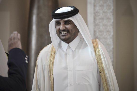 [Culture]Les Couvres-Chefs 713116-nouvel-emir-qatar-cheik-tamim