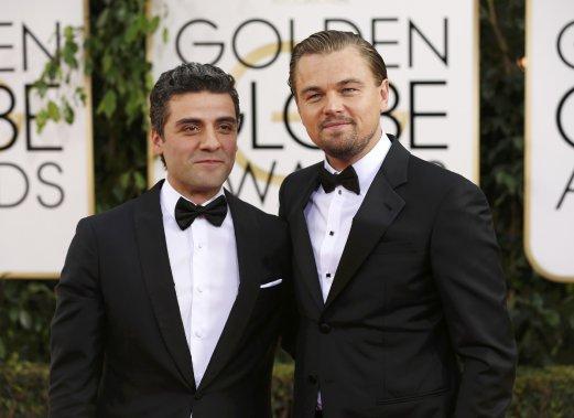 Les acteurs Oscar Isaac et Leonardo DiCaprio. (Photo MARIO ANZUONI, Reuters)