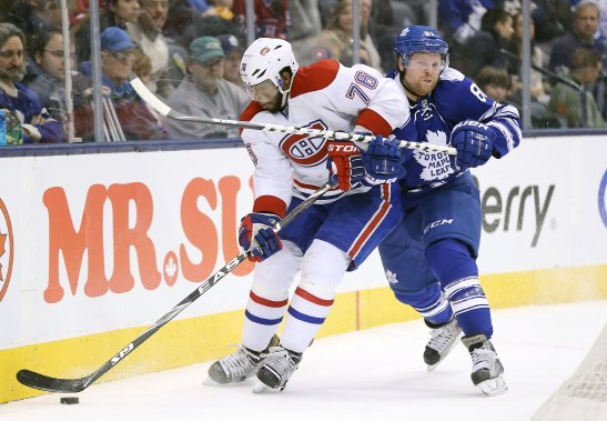 Le défenseur du Canadien P.K. est poursuivi par l'attaquant des Maple Leafs Phil Kessel. (Photo Tom Szczerbowski, USA Today)