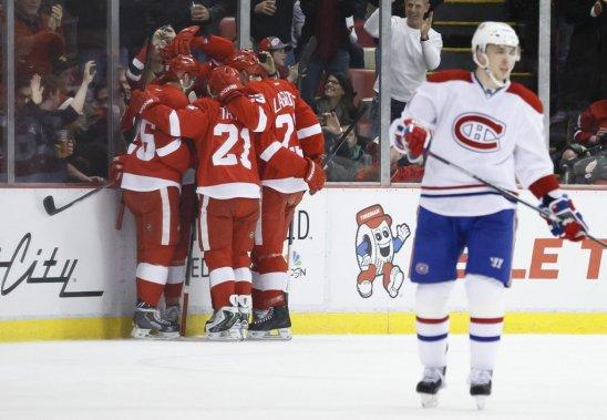 Les Wings célèbrent un de leurs buts. (Photo USA TODAY Sports)