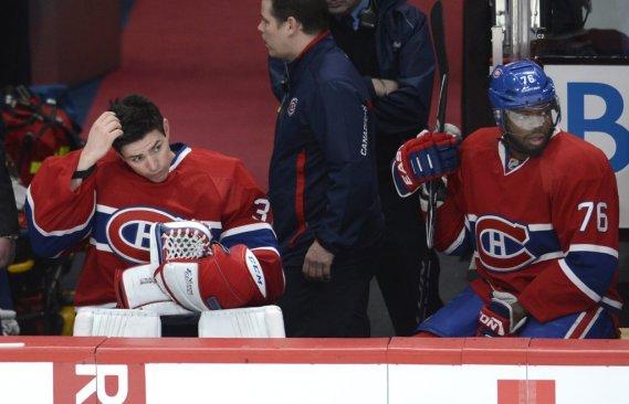 Carey Price, la mine déconfite après avoir accordé quatre buts sans riposte, et PK Subban. (Photo Bernard Brault, La Presse)
