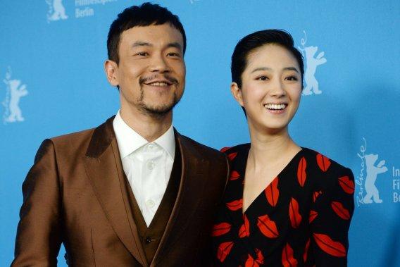 Mercredi 12 février 2014 : Les acteurs chinois Liao Fan et Gwei Lun Mei ont présenté le film «Bai Ri Yan Huo» («Black Coal, Thin Ice») à la Berlinale. (Photo: AFP)