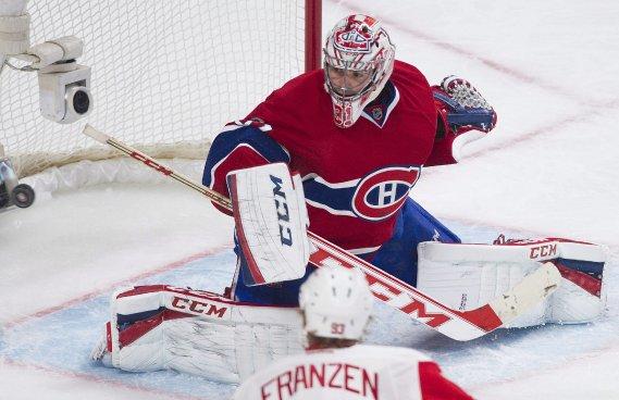 Carey Price fait un arrêt sur un tir de Johan Franzen. (Photo Graham Hughes, La Presse Canadienne)