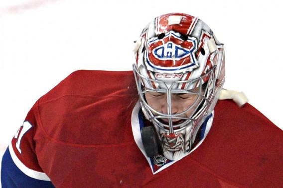 Carey Price ferme les yeux après avoir effectué un arrêt avec son masque. (PHOTO BERNARD BRAULT, LA PRESSE)