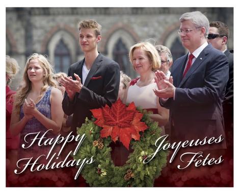 Stephen Harper accompagné de sa femme Laureen et de ses enfants Ben et Rachel, sur sa carte de Noël 2014. (La Presse Canadienne)