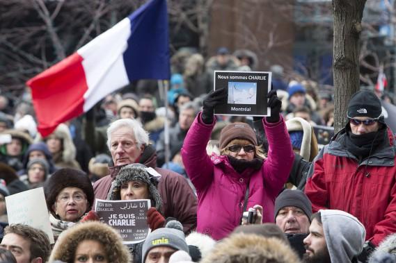 Quelque 25 000 personnes ont marché dimanche à Montréal et près de 2000 à Québec en hommage aux 17 personnes tuées par trois djihadistes français dans des attaques à Paris. (Photo Robert Skinner, La Presse)