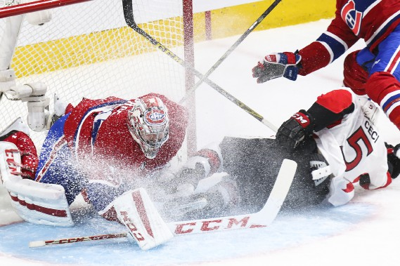 Cody Ceci entre en contact avec Carey Price. (Patrick Woodbury, LeDroit)