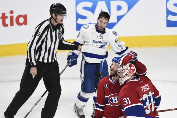 Brandon Prust célèbre la victoire du Canadien avec Carey Price devant l'attaquant du Lightning Tyler Johnson. (PHOTO BERNARD BRAULT, LA PRESSE)