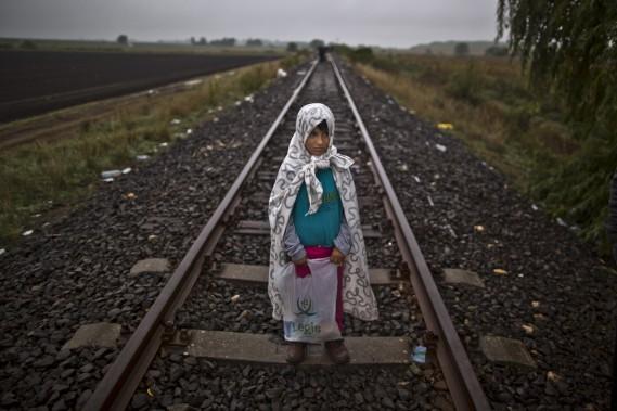 Nous voulons seulement vivre dans un pays qui nous traite comme des humains. Nos maisons sont détruites, nous vivons chaque jour dans la peur de, non seulement Bashar Assad, mais aussi de l'État islamique. (Associated Press, Muhammed Muheisen)