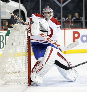 Carey Price bloque un tir haut. (PHOTO PAUL BERESWILL, AP)