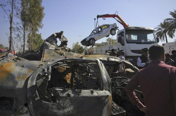 De longues files de voitures attendant de passer les contrôles de la sécurité se forment habituellement autour du <em>checkpoint</em> à cette heure de la journée. (AP, Anmar Khalil)