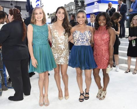 Les gymnastes de l'équipe olympique américaine:Madison Kocian, Aly Raisman, Laurie Hernandez et Simone Biles (AP, Chris Pizzello)
