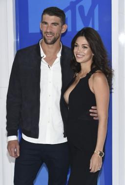 La légende olympique de natation Michael Phelps et sa femme Nicole Johnson (AP, Evan Agostini)
