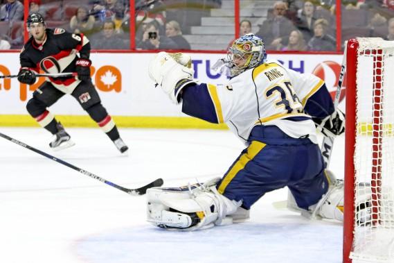 Chris Wideman voit son tir être arrêté par Pekka Rinne. (Patrick Woodbury, Le Droit)
