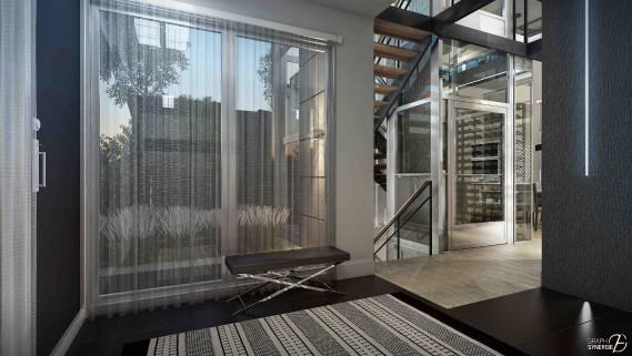 L'ascenseur vitré est enserré entre l'escalier et le cellier, dans un ensemble qui compose le hall. (Fournie par Graph Synergie)