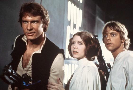 Harrison Ford, Carrie Fisher et Mark Hamill dans une scène de Star Wars, en 1977 (La Presse canadienne)