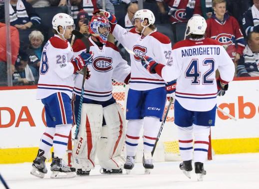 Les joueurs du Canadien célèbrent leur victoire à la fin d'un véritable festival offensif. (Photo Bruce Fedyck, USA TODAY Sports)