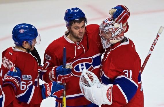Carey Price (à droite) a repoussé 30 des 31 tirs des Flames, tandis qu'Alexander Radulov (au centre) a marqué deux fois, et le Canadien l'a emporté 5-1, mardi soir, au Centre Bell. (Photo André Pichette, La Presse)