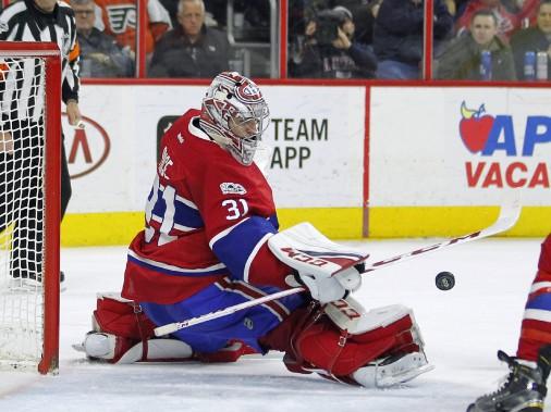 Carey Price a dû se dresser à de nombreuses reprises devant les tirs et les chances de marquer de l'adversaire, surtout en troisième période. (Photo Tom Mihalek, Associated Press)