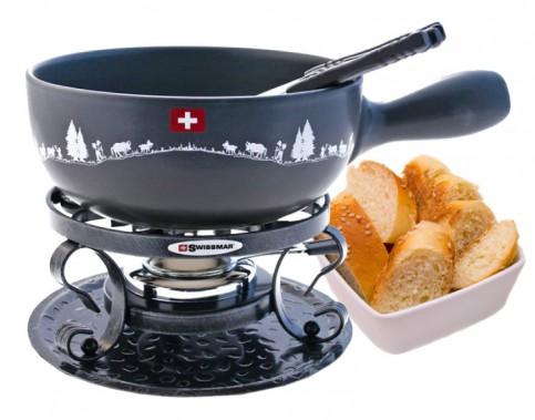 Service à fondue au fromage, en fonte, Swisstradition de Swissmar, 9 pièces. La fondue au fromage se déguste avec du pain. On peut aussi l'accompagner de charcuteries, de cornichons et de petits oignons marinés. ()