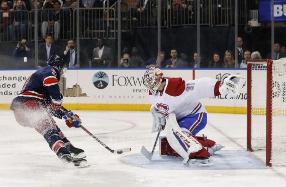 En deuxième période, le gardien Carey Price a bloqué un tir de Rick Nash... qui s'est repris quelques minutes plus tard et a déjoué le cerbère de Montréal. (Photo Julie Jacobson, AP)