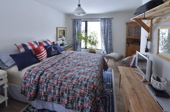 Le lit de la chambre d'amis est composé de deux bases en bois qui peuvent être séparées ou réunies selon le désir des invités. (Le Soleil, Patrice Laroche)