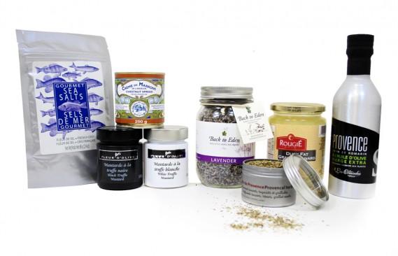 Quelques aliments, accompagnements et condiments essentiels de la cuisine française. Fleur de sel, crème de marron, gras de canard en pot, pots de moutarde aux truffes et à l'huile d'olive, herbes de Provence, lavande, huile d'olive. (Mélissa Bradette)