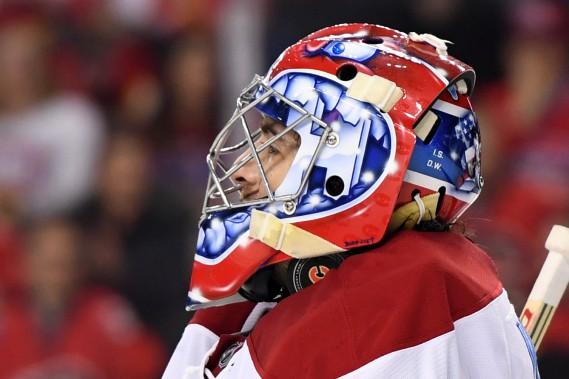 Le gardien du Canadien Al Montoya emprisonne la rondelle dans son masque. (Photo Candice Ward, USA TODAY Sports)