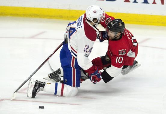 Tom Pyatt et Phillip Danault sont entrés en collision en première période. (Photo Adrian Wyld, La Presse canadienne)