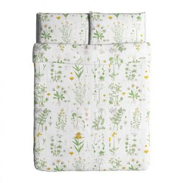 Housse de couette et taies d'oreillers à motif floral, de la collection STRANDKRYPA. Ikea Canada ()
