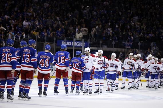 La traditionnelle poignée de main, entre les gagnants, les Rangers, et les perdants, les joueurs du Canadien. La saison 2016-2016 du CH s'est terminée samedi, à New York. (Photo Adam Hunger, USA TODAY Sports)