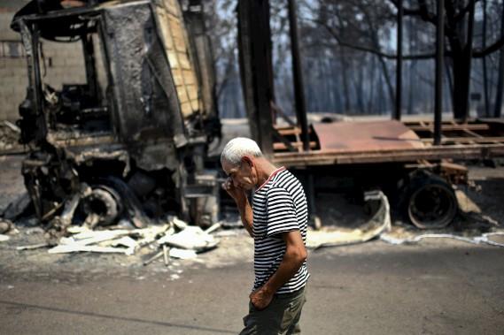 Désolation et consternation aux endroits où le feu a fait rage, comme ici àFigueiro dos Vinhos. (AFP, Patricia De Melo Moreira)