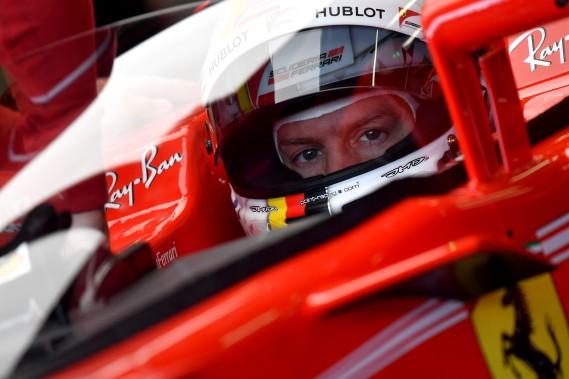 Sebastian Vettel, avant de s'engager en piste pour la 1ère séance d'essais libres. (AFP)