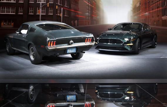 Ford a présenté la Mustang Bullitt 2019 (à d.) aux côtés de la Mustang fastback originale, pilotée par Steve McQueen dans les plans rapprochés de la scène de poursuite du film Bullitt. (AP)