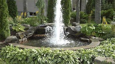 Bassins et fontaines pour le jardin marc beauchamp for Prix amenagement jardin