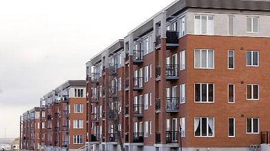 Toutes les maisons en rangée sont identiques, ce...