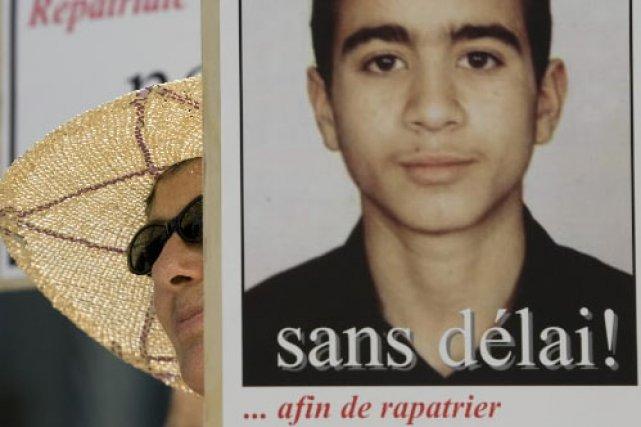 Des manifestants réclament le rapatriement d'Omar Khadr.... (Photo: David Boily, La Presse)