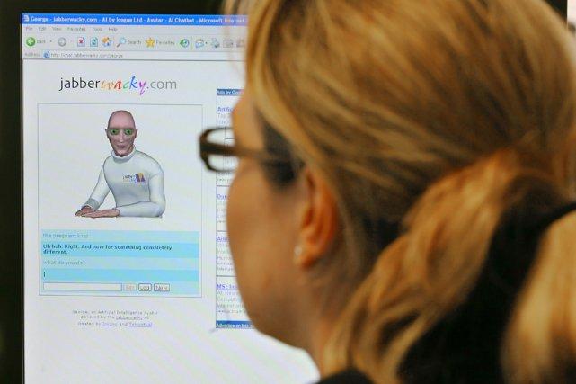 Une femme devant son ordinateur... (AFP)